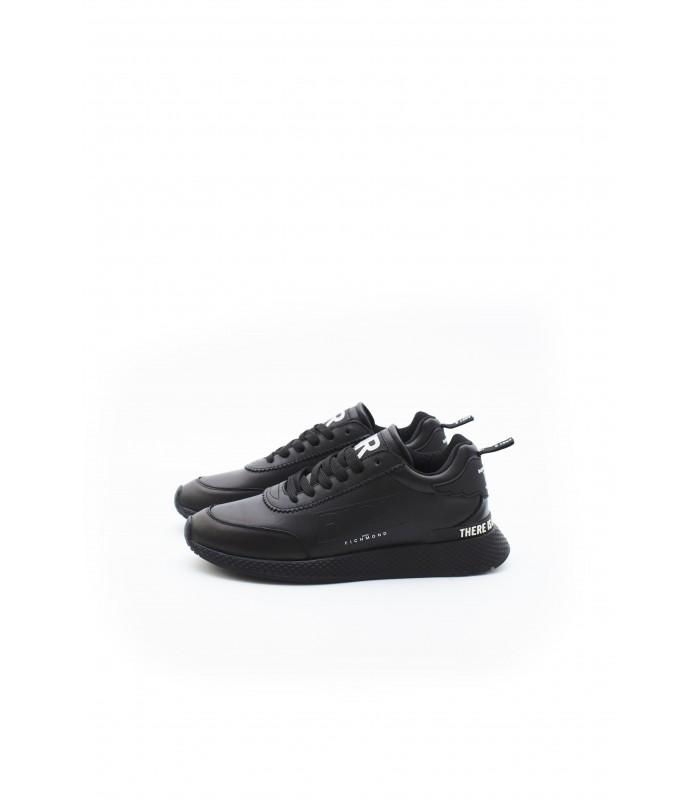 Кросівки чорні шкіряні з білим надписом