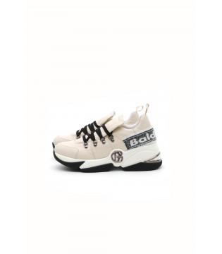 Кросівки бежеві з чорним на фігурній підошві